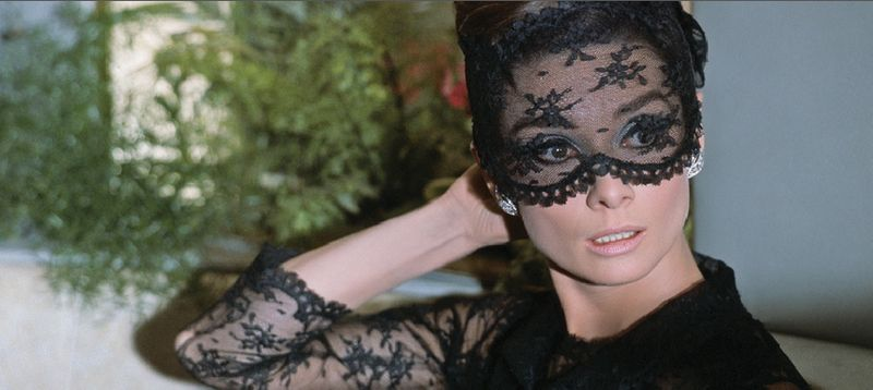 1 = 1,000- Audrey Hepburn in black lace mask on The Fashion Informer