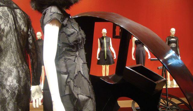 Comme des Garcons lace dress (l) and Marc Jacobs dress (r) detail with Rachel Feinstein's sculture at André Leon Talley LBD:SCAD exhibit; photo by Lauren David Peden:The Fashion Informer
